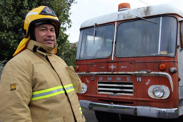 Those were the days: Porirua volunteer firefighter Alamaine Thomas with the old Porirua fire truck, commissioned in 1966